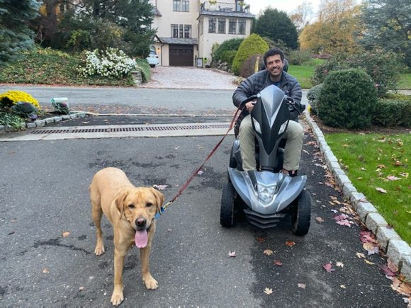 man with his service dog outside